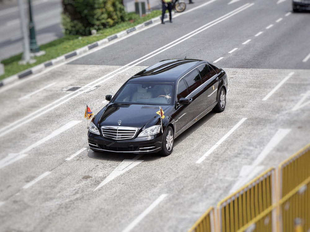 black Mercedes-Benz vehicle on road