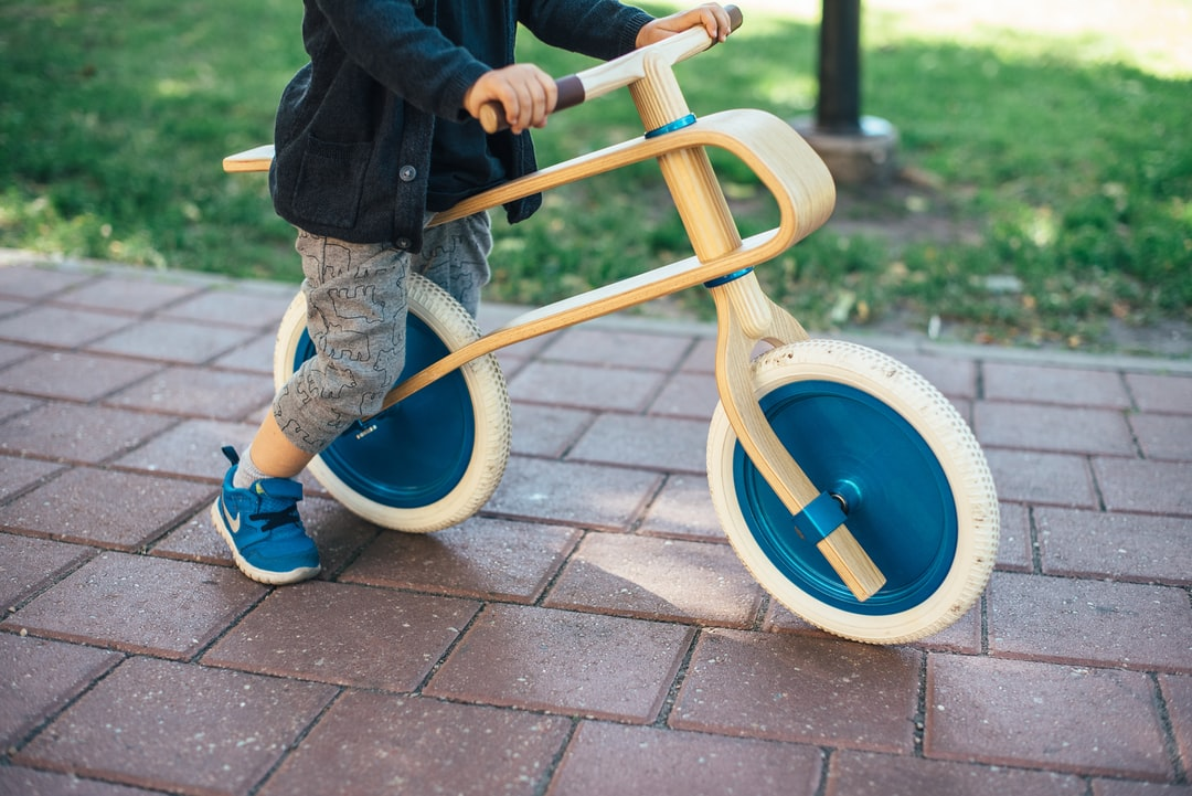 Our son, Ezra River and one of the most beautifully designed balance bikes for toddlers - made from oak - BrumBrum.