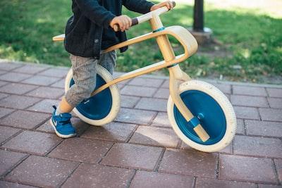 toddler riding balance bike latvia zoom background