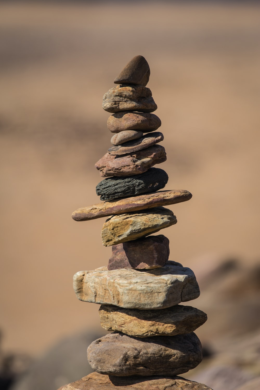selective focus photography of balance stones