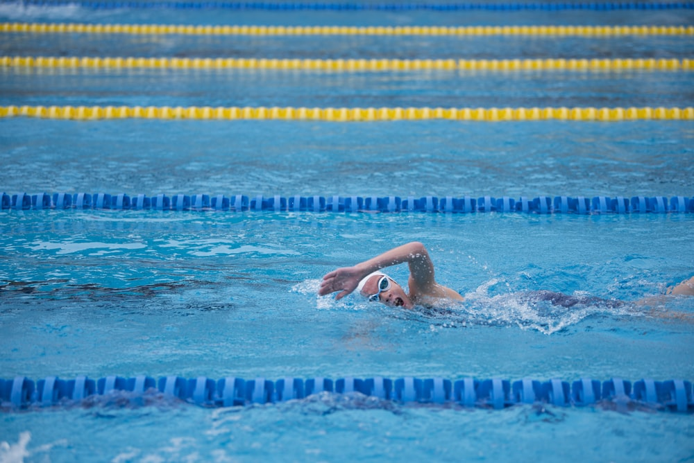 woman swimming on pool