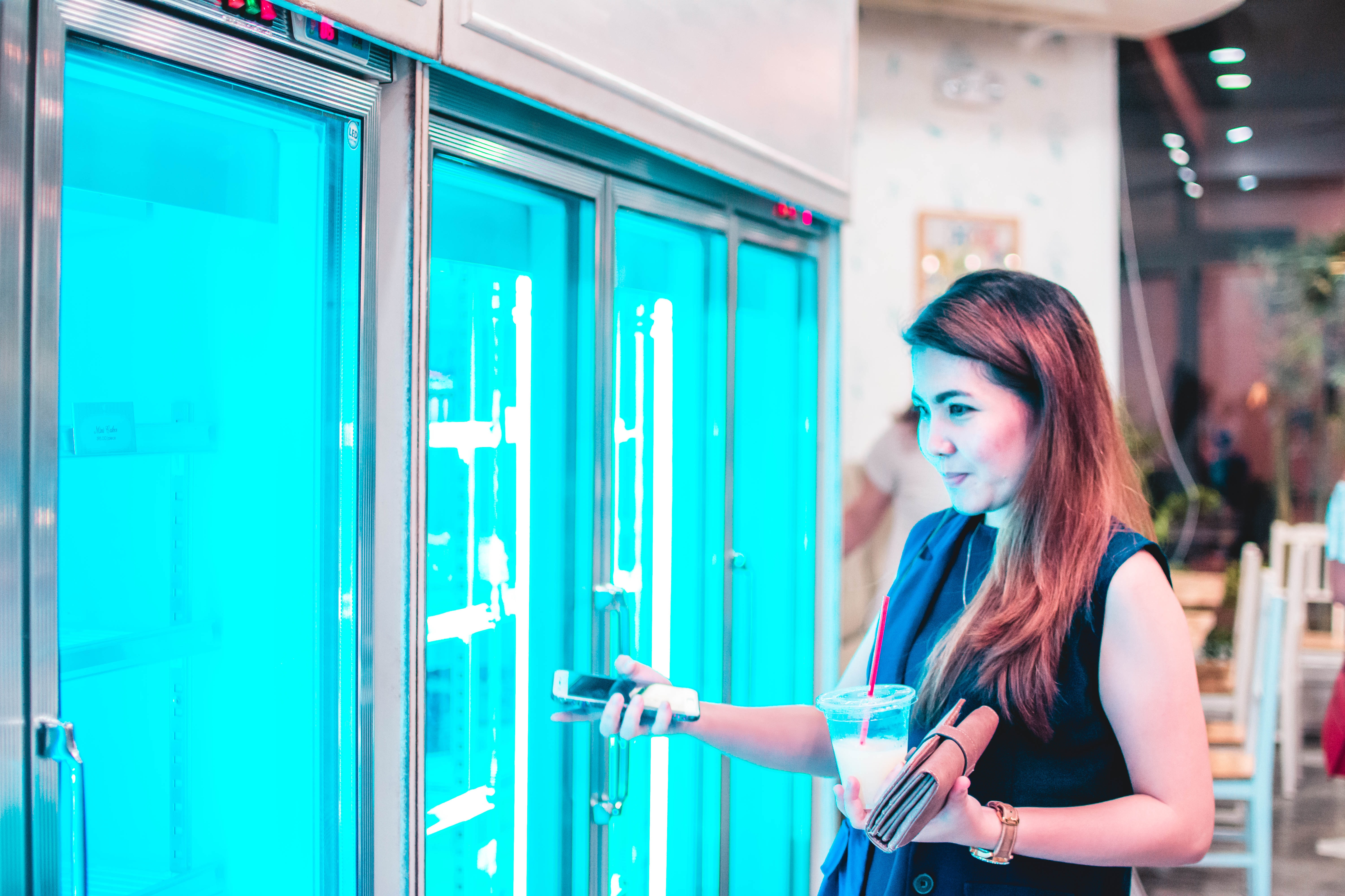 woman fronting commercial refrigerator