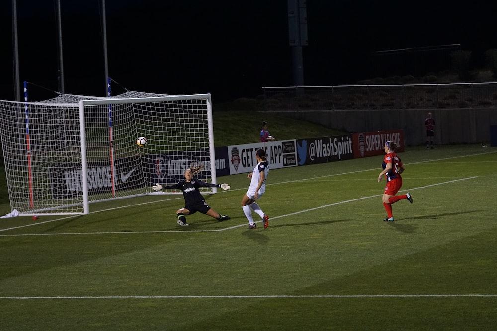 soccer player making goal