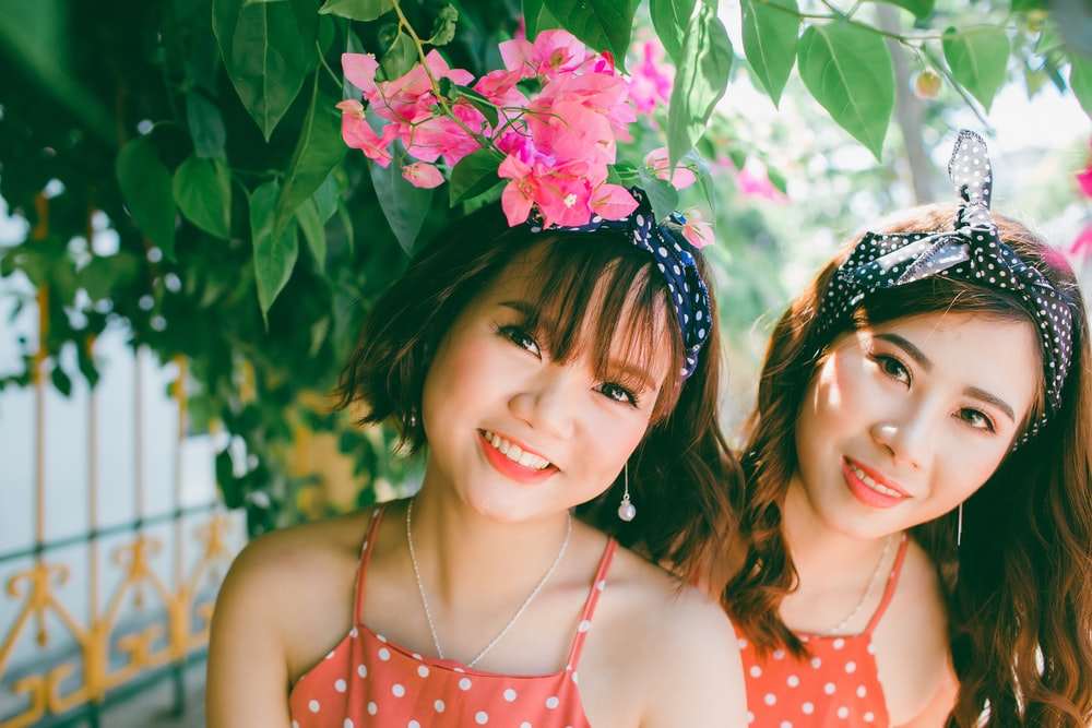 two women earring Alice bands