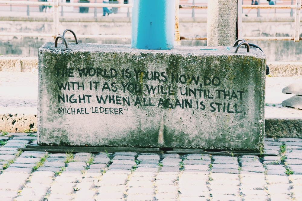 gray concrete with quotes on pavement