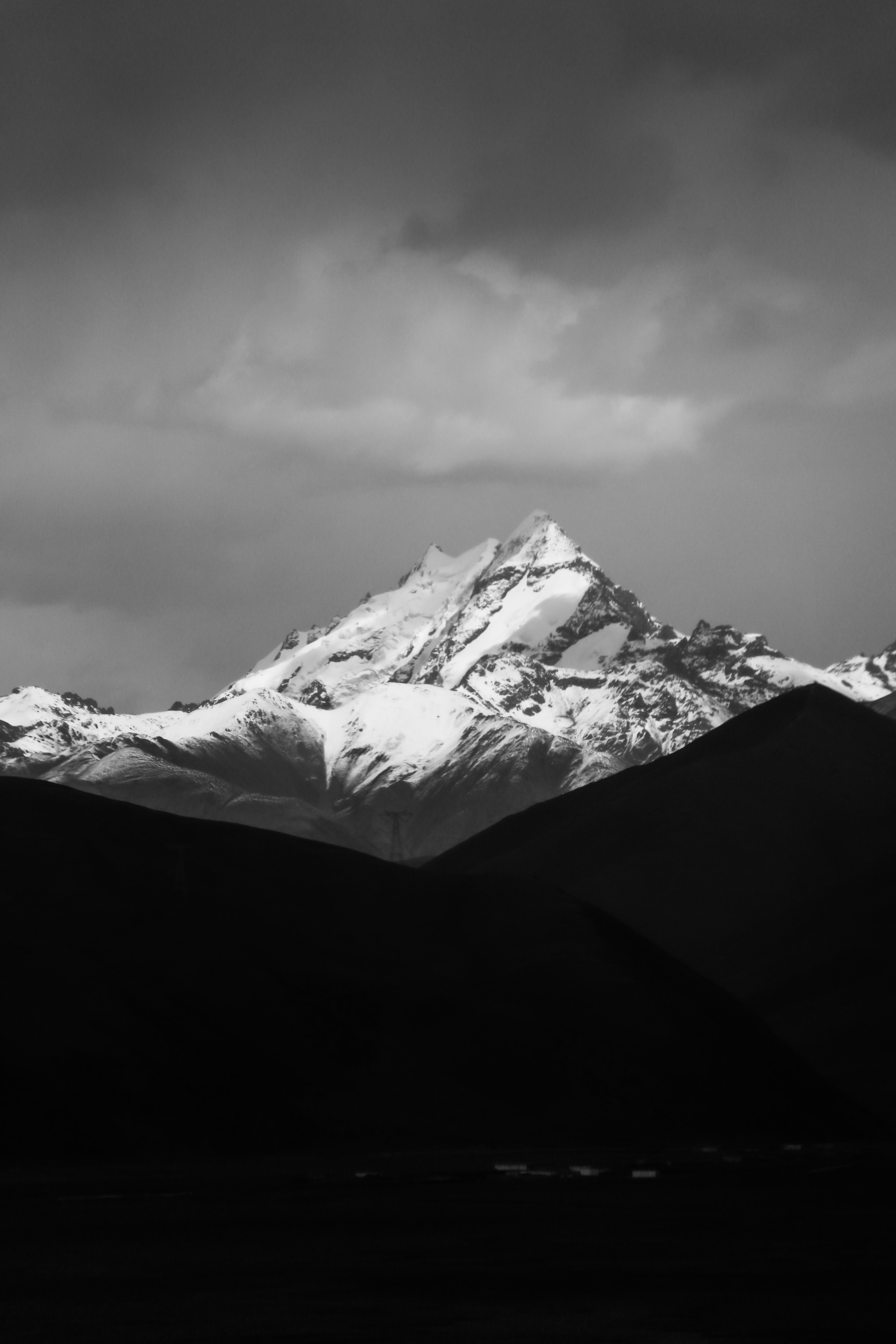 grayscale photo of mountain coated snow