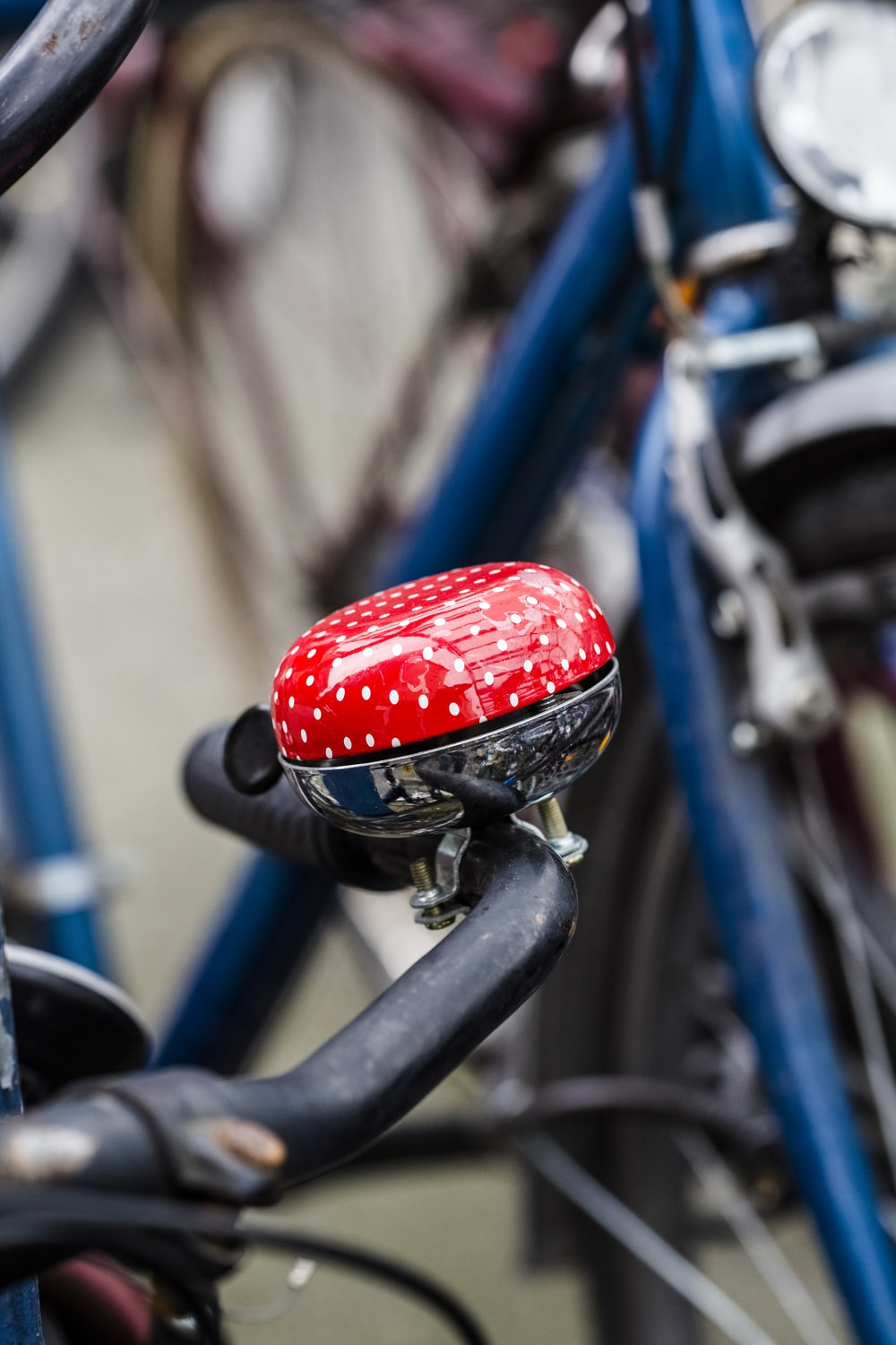 red and blue bicycle bell on black bicycle