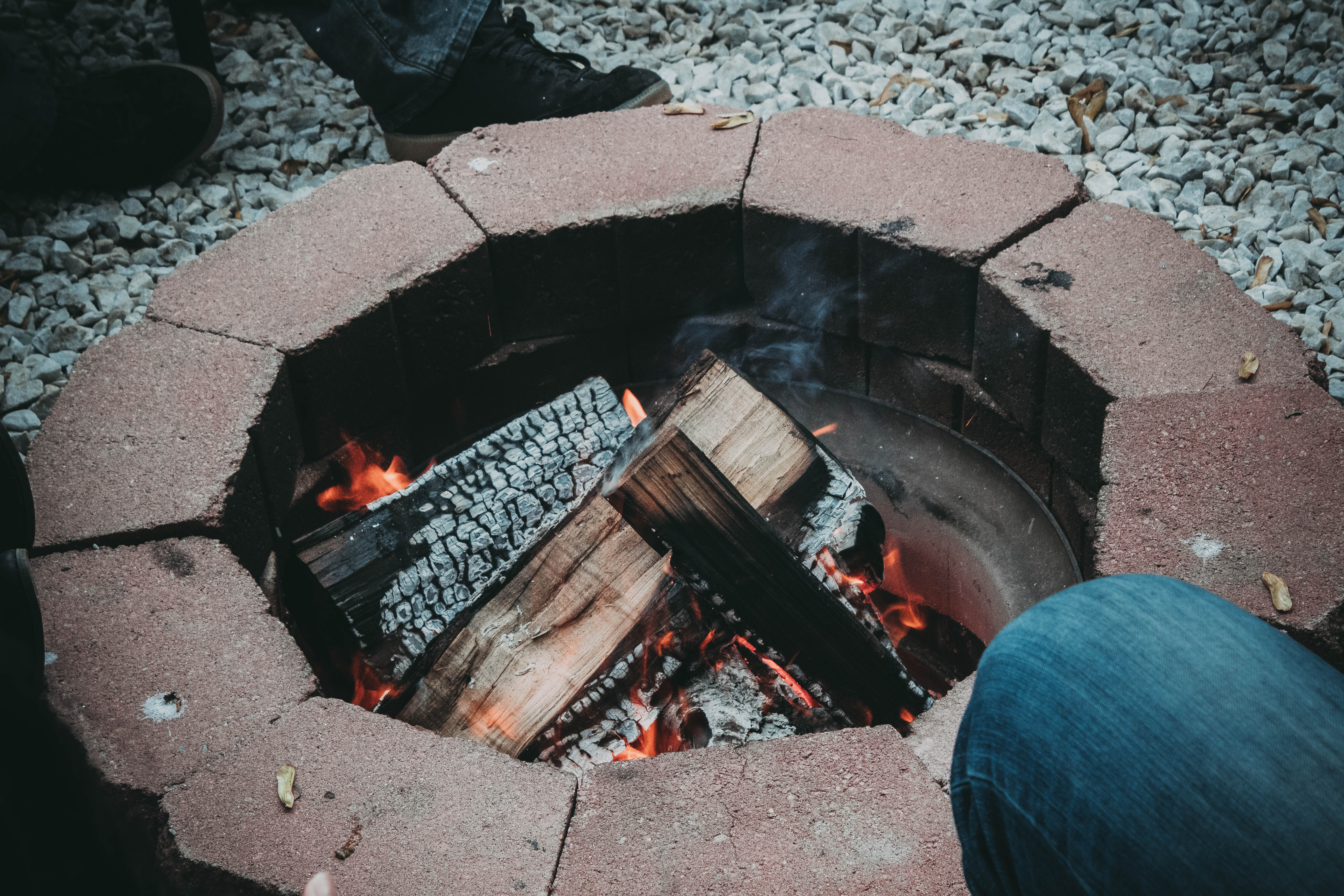 photo of burning wood logs in firepit
