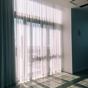 white glass panel curtains