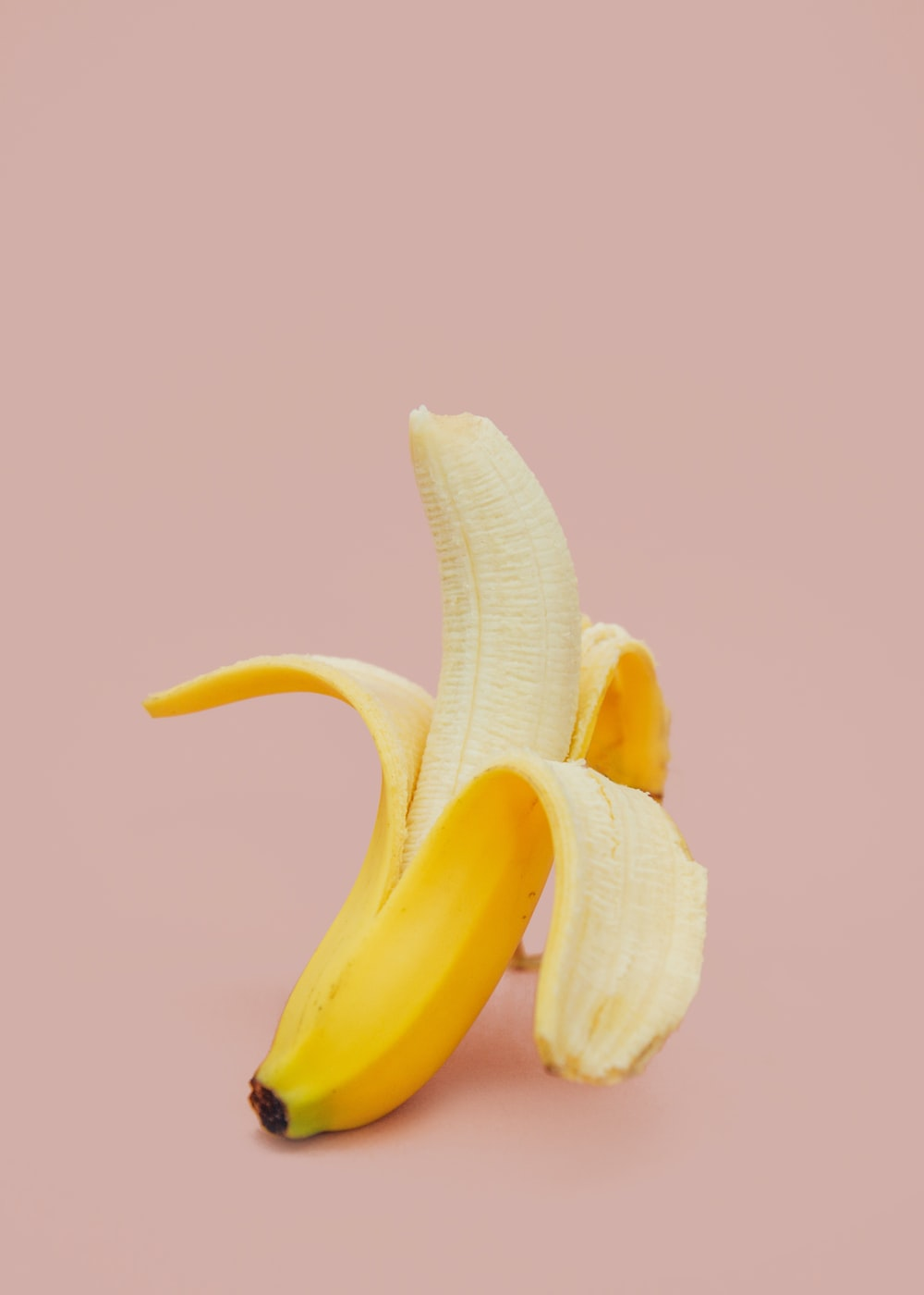 half peeled banana fruit