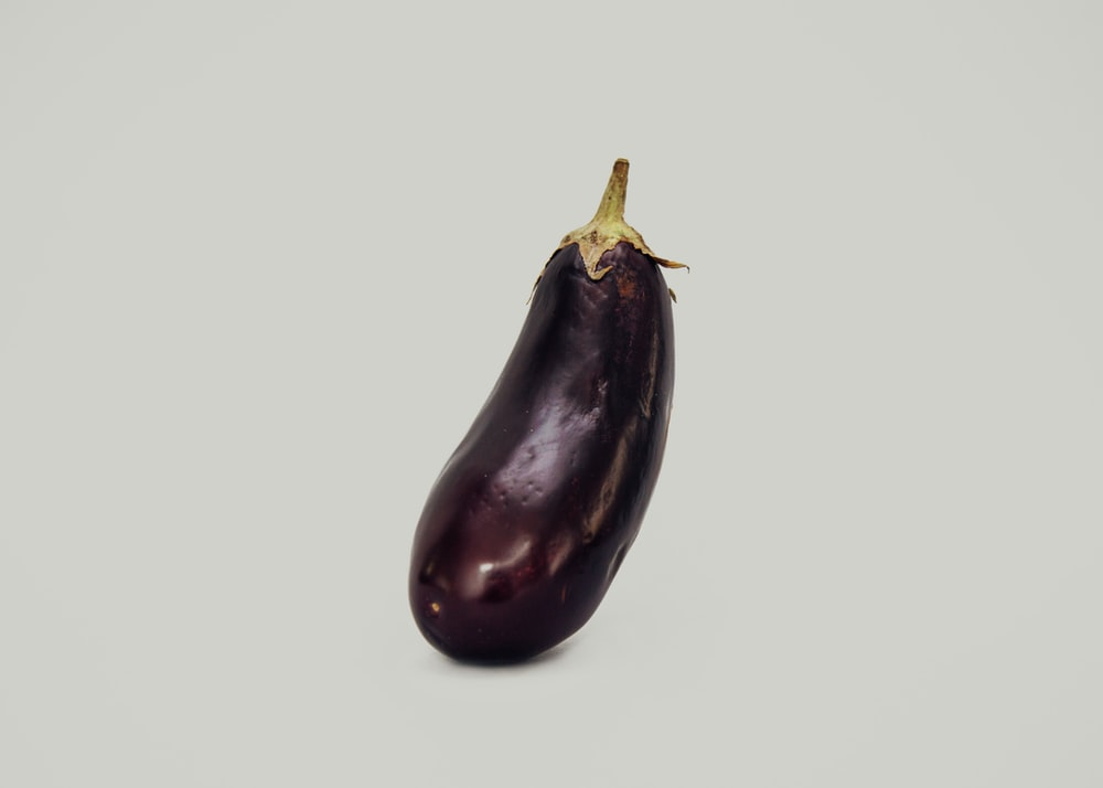 purple eggplant against white background