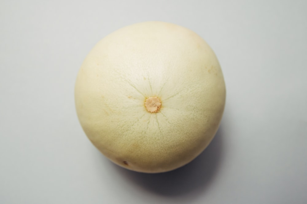 round brown fruit placed on white surface