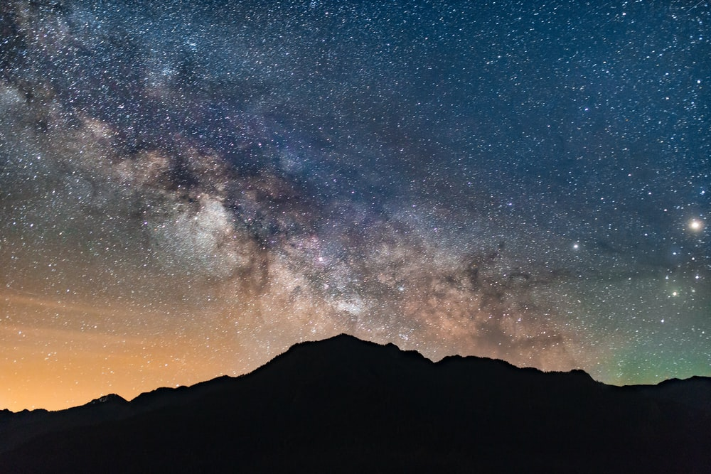 silhouette photo of mountain during nighttime