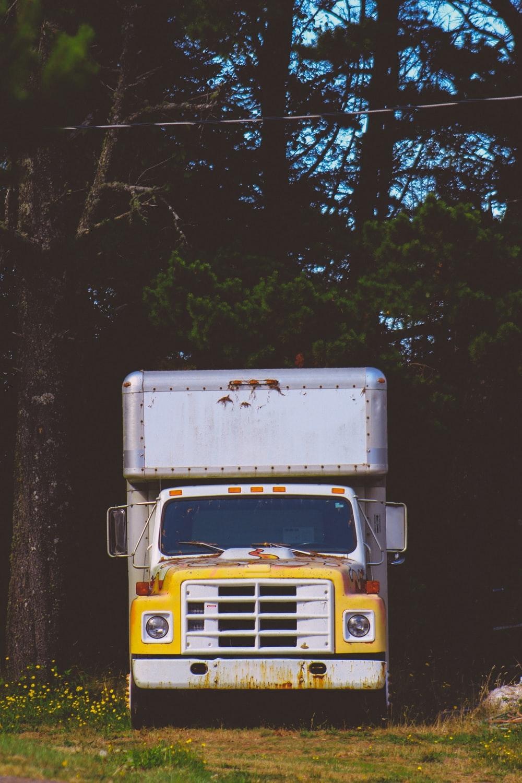 closeup photo of white and yellow box truck