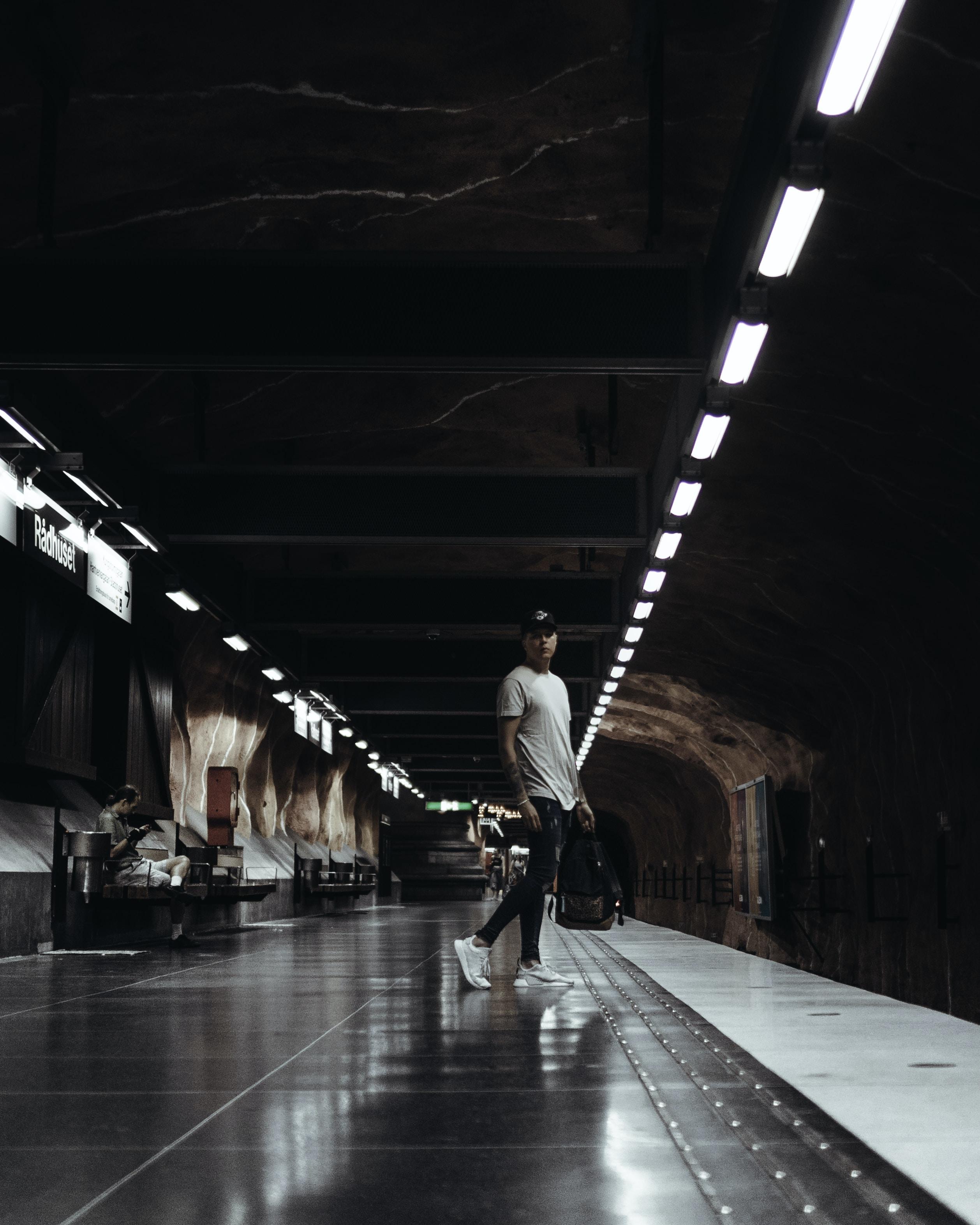 man standing on subway