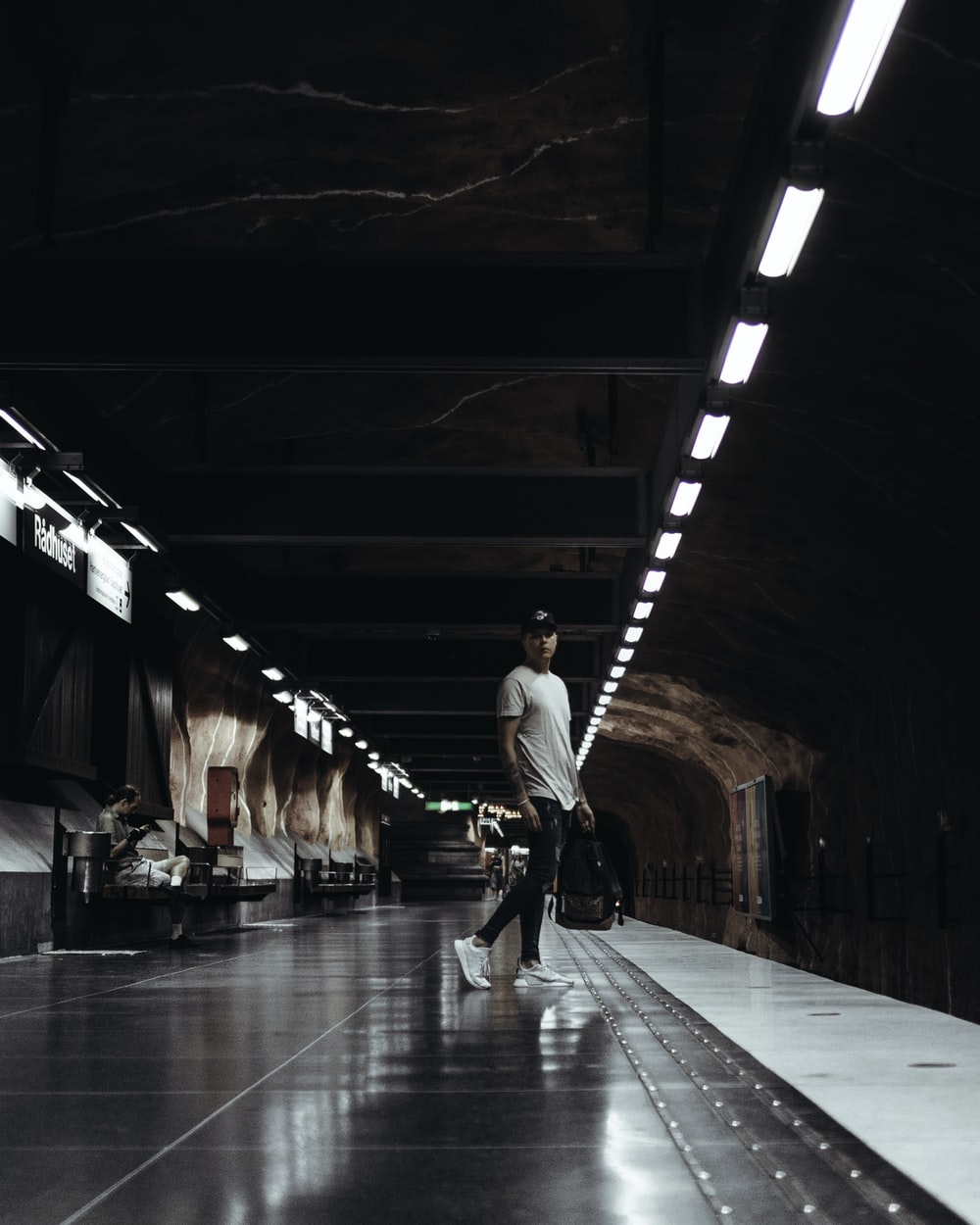 man standing on subway