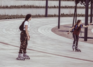 two women inside park while on inline skates