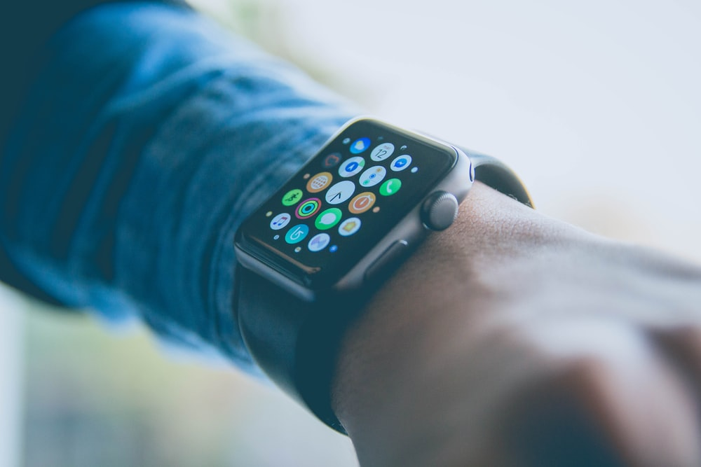 person wearing space gray aluminum case Apple Watch