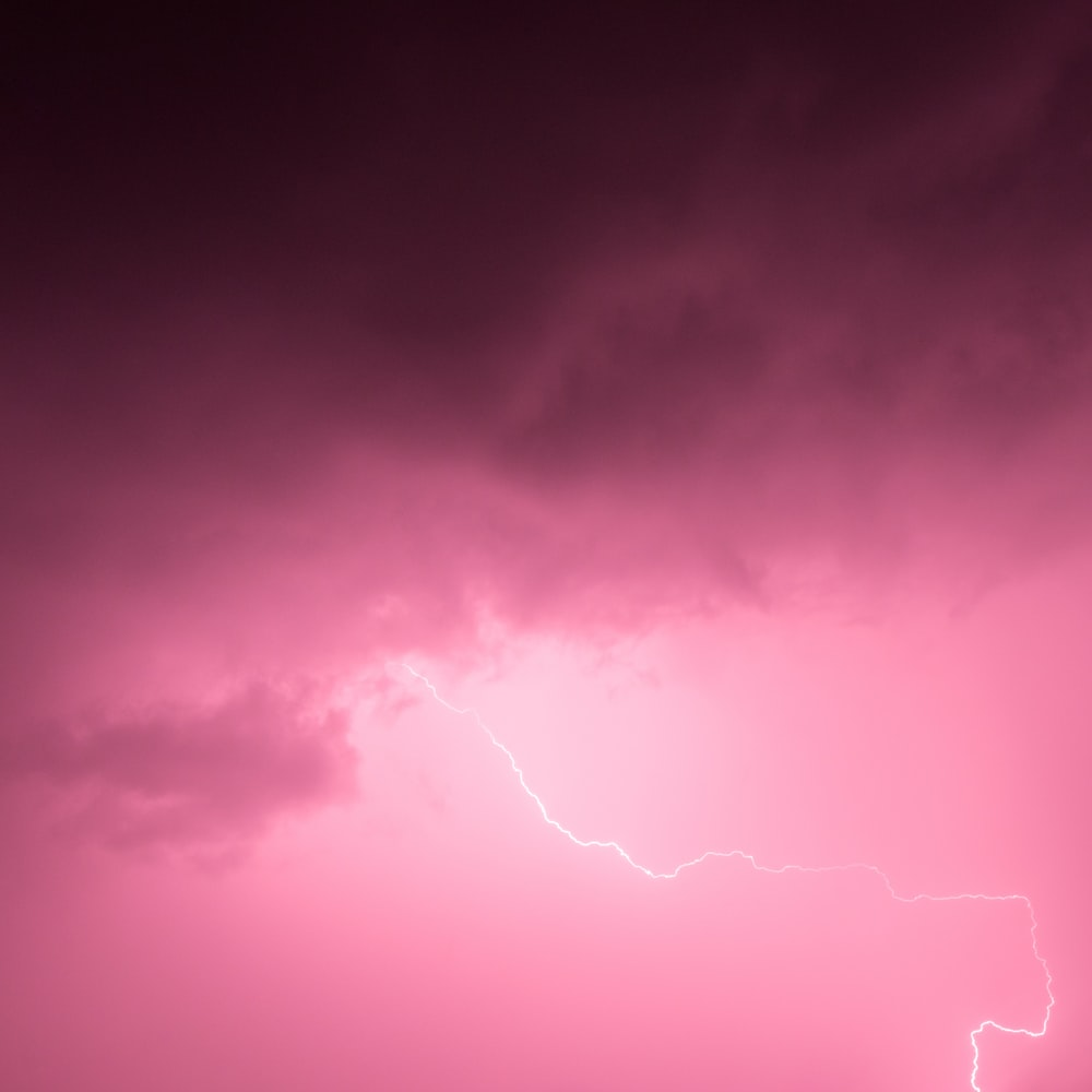 photography of pink cloud with thunder