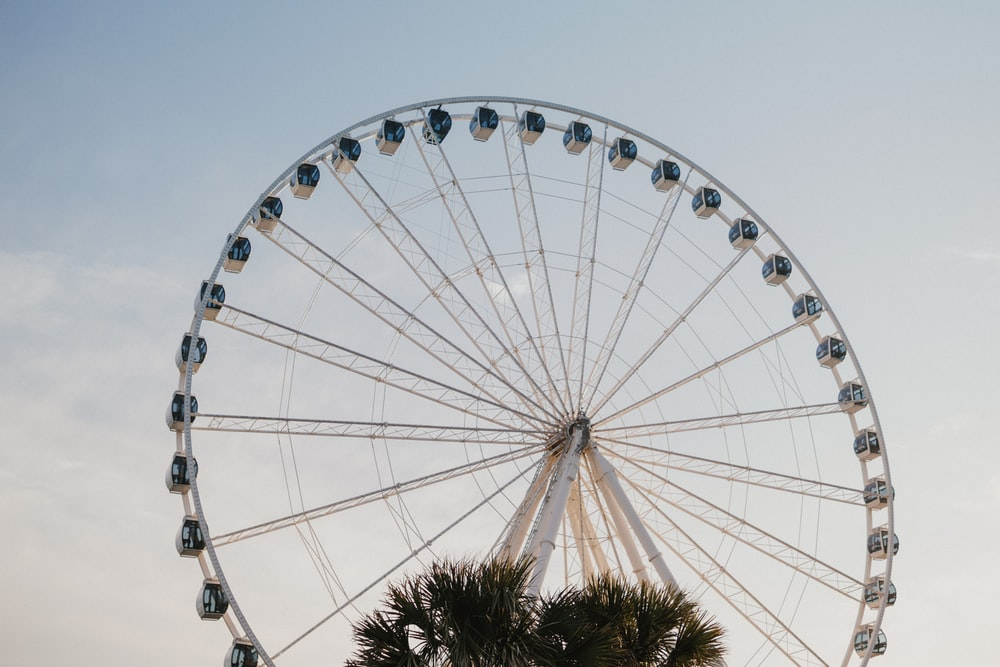 low-angle of white ferris wheel