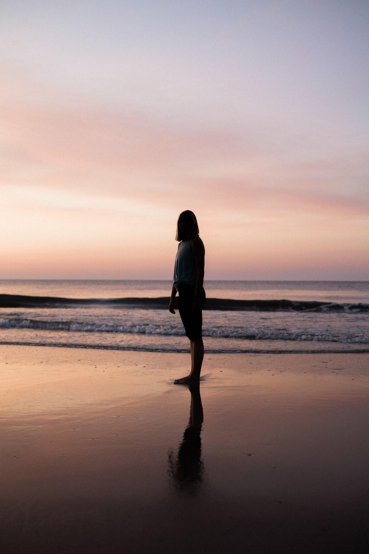 woman standing seashore