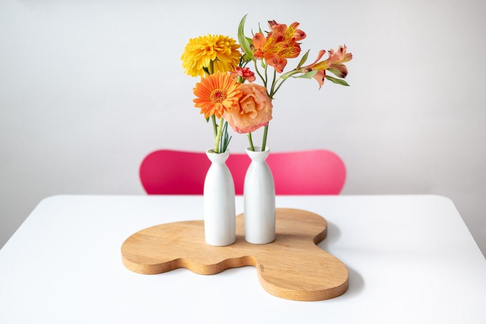 orange and yellow petaled flowers on table