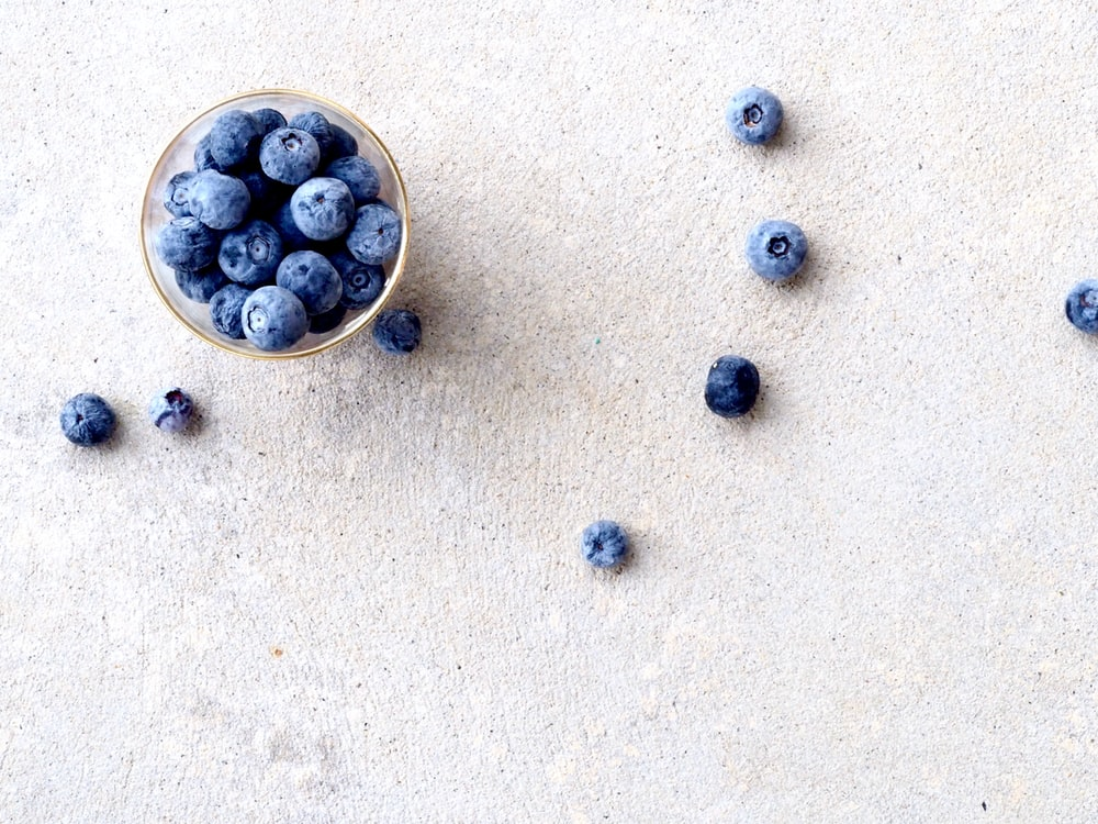 blueberries in clear glass bowl