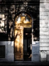 opened brown wooden door