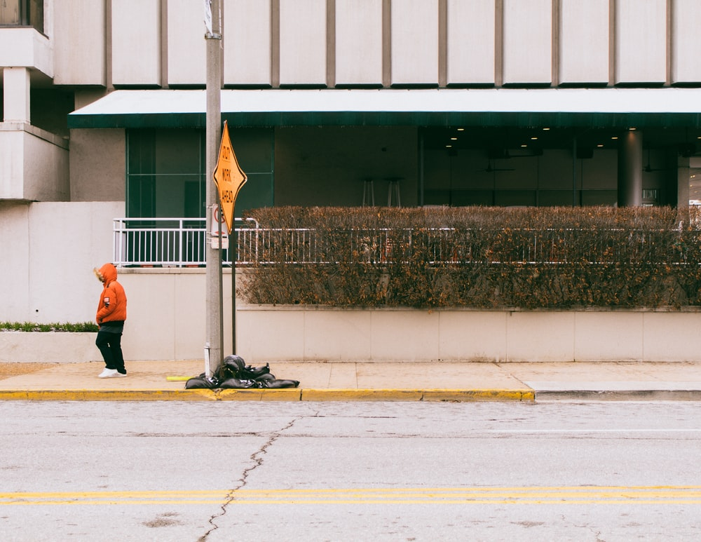 person standing on sidewalk