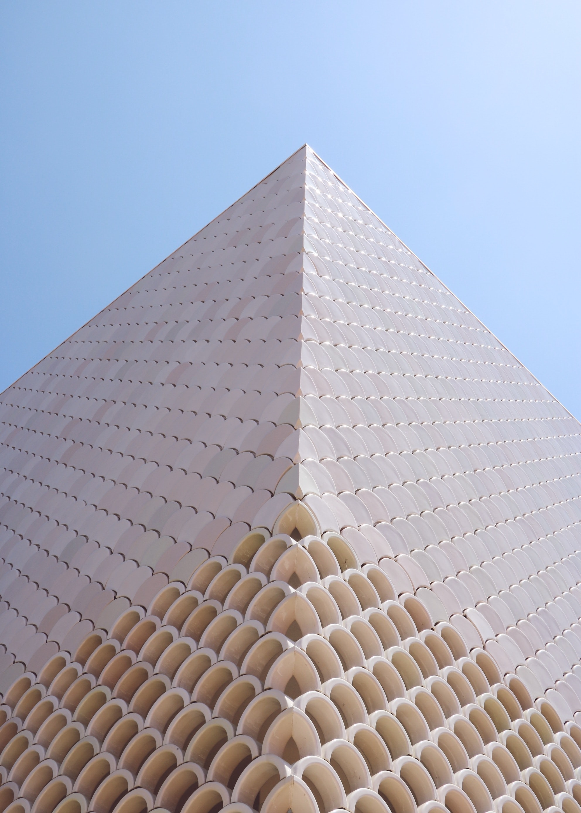 low-angle photography of beige building