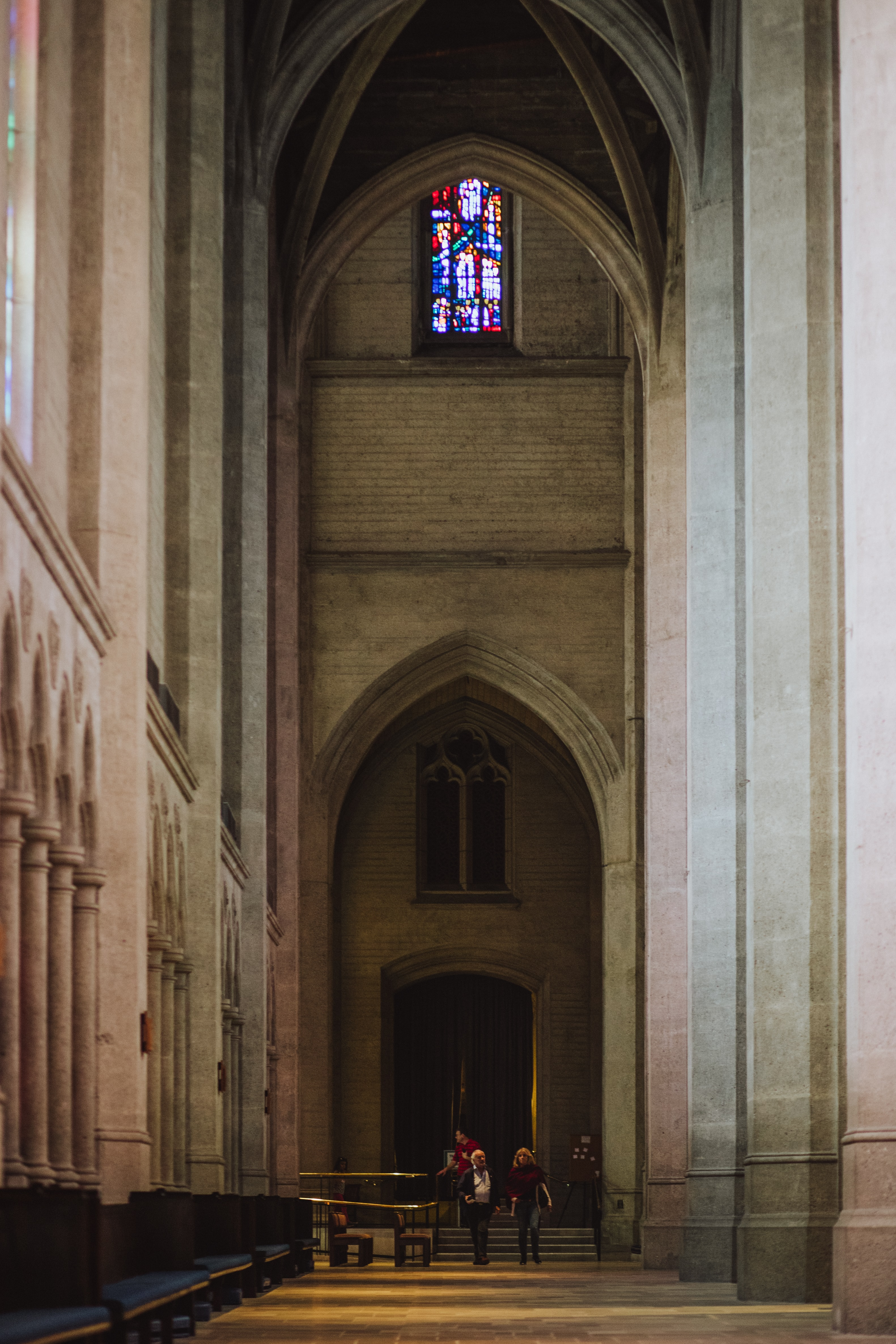 two woman standing on hallway in cathedral