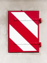 closeup photo of red and white door