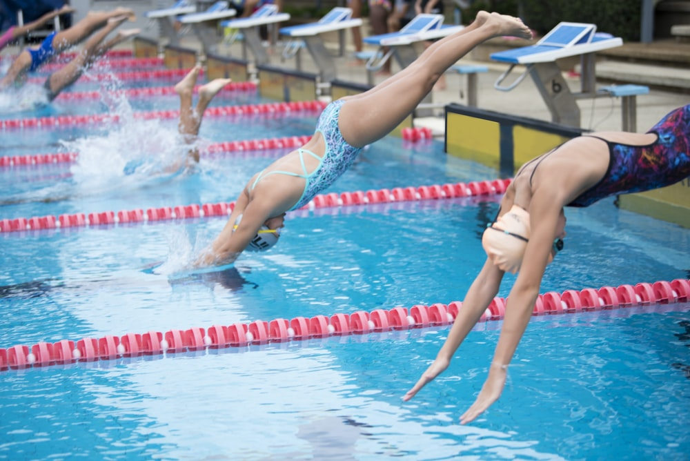 photography of competing swimmers