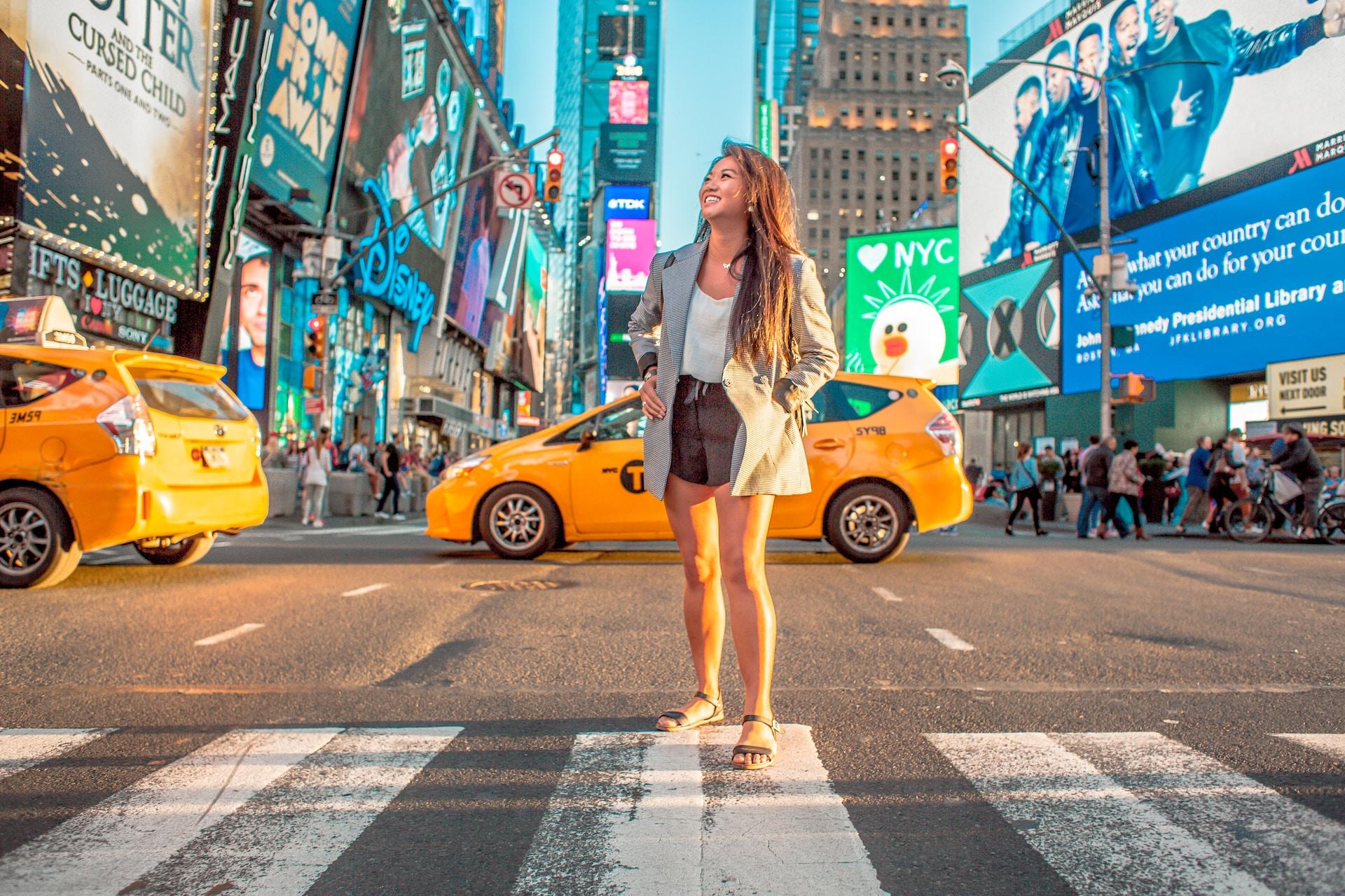 woman standing on pedestrian lane