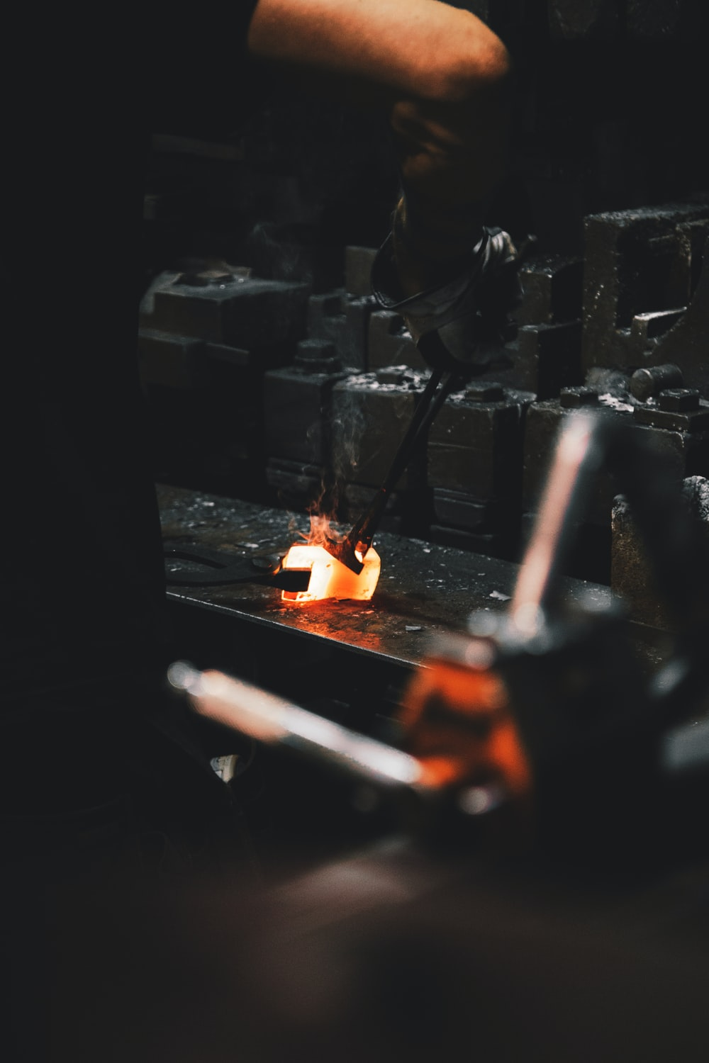person holding forging tong
