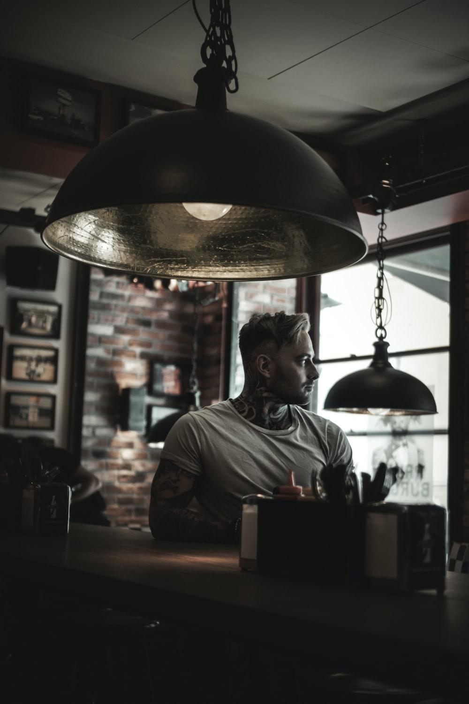man sitting near pendant lamp
