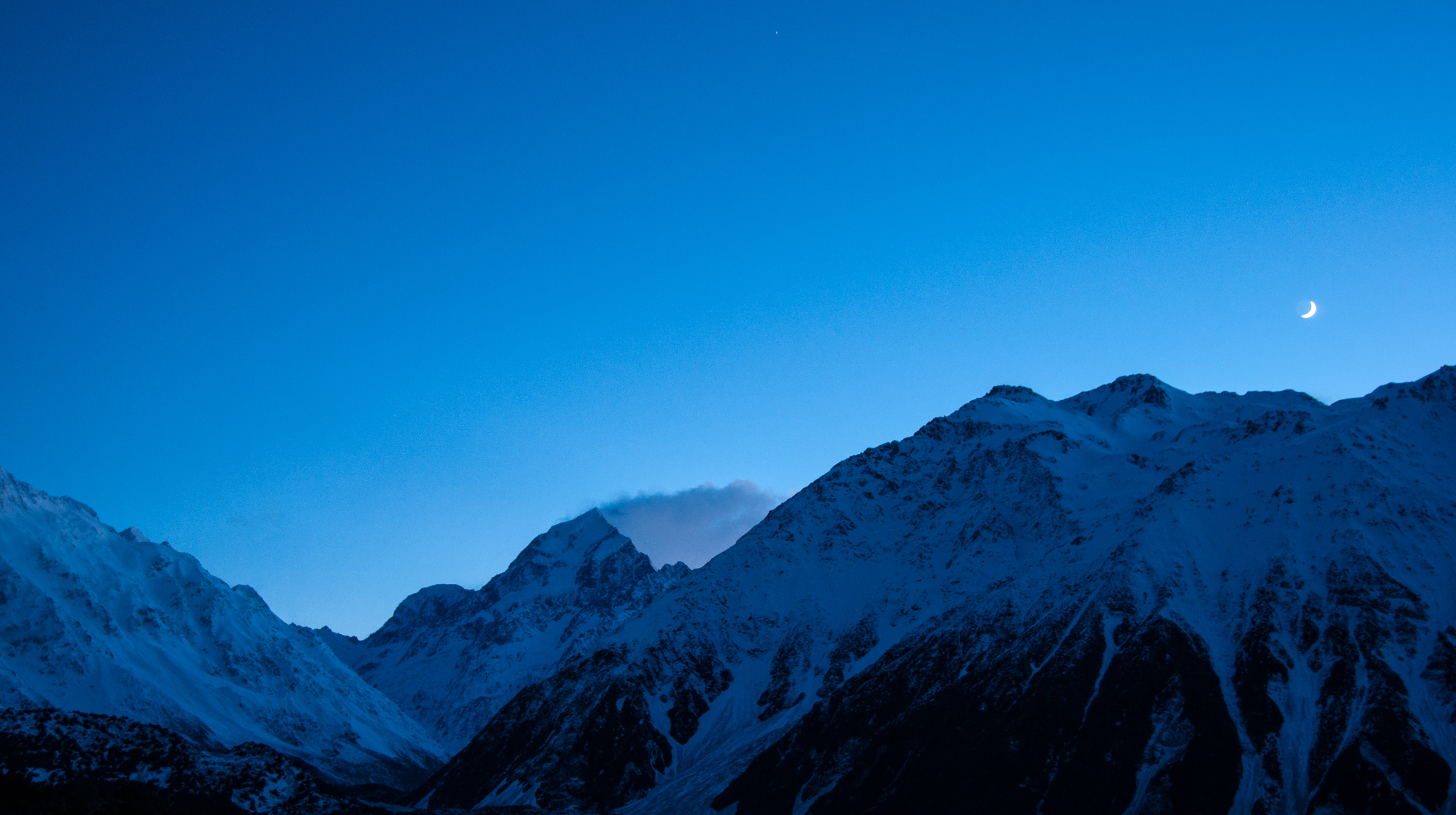 snow-capped mountain under blue sky