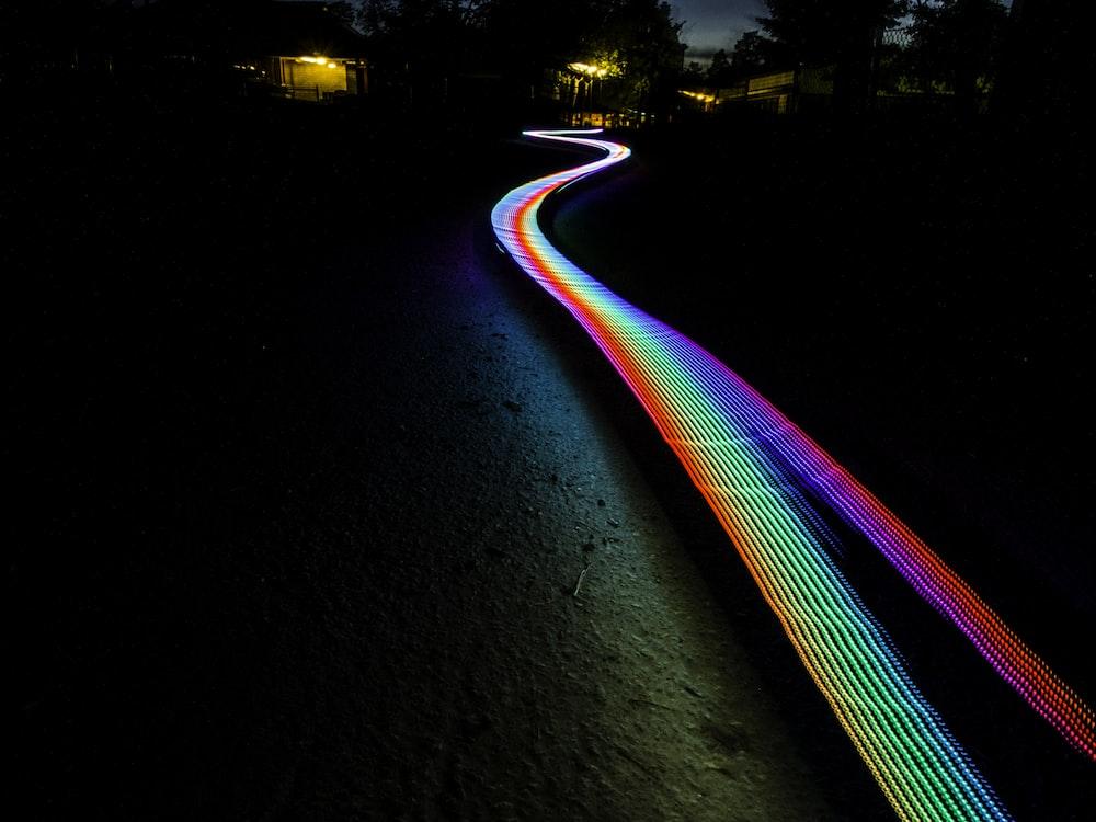 multicolored light passage in dark area