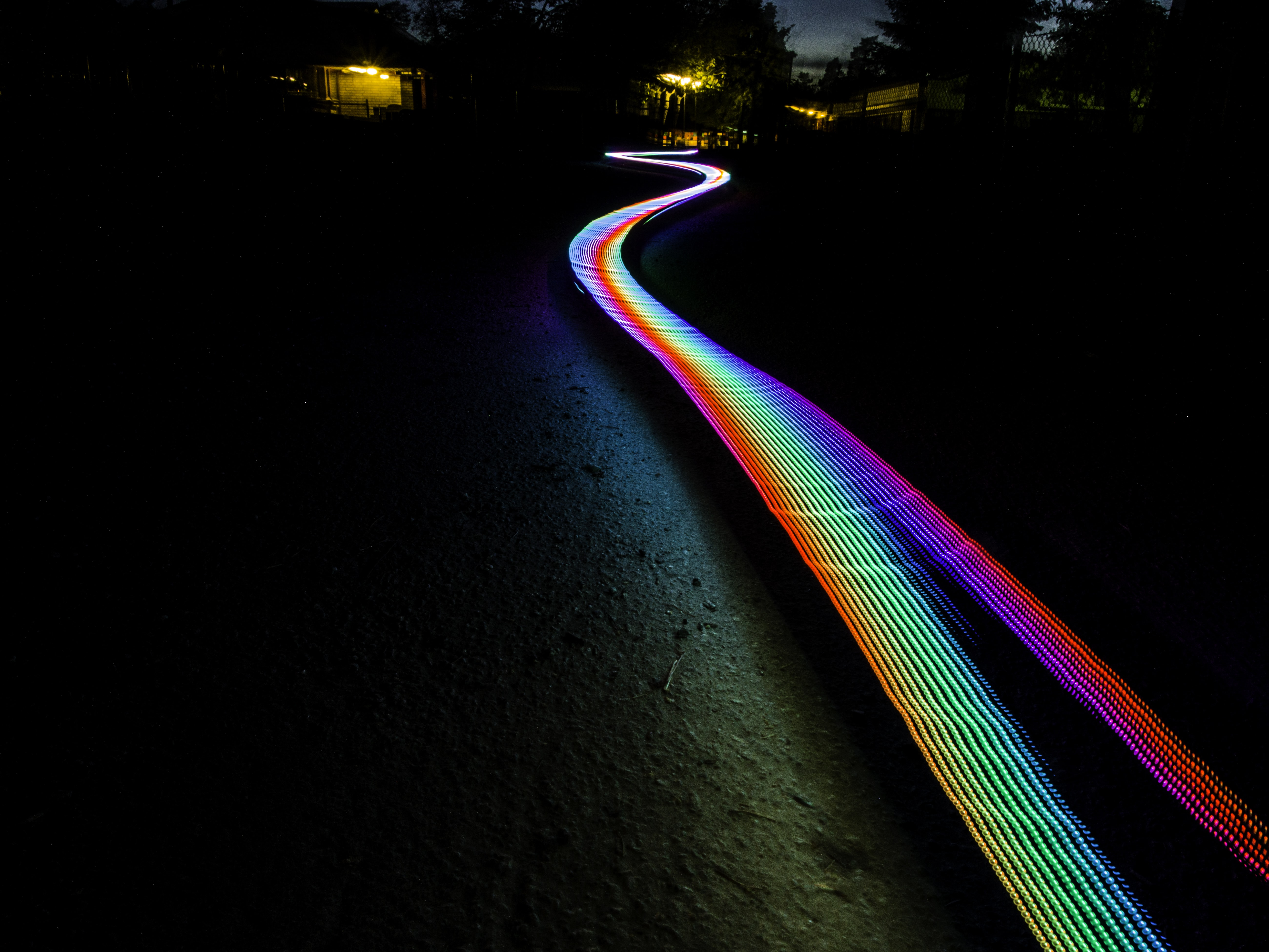 multicolored light passage in dark area