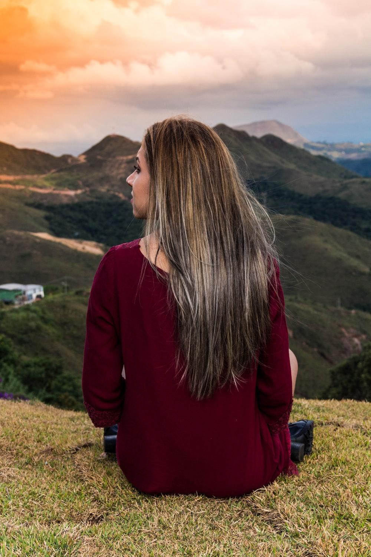 woman sitting on green grass