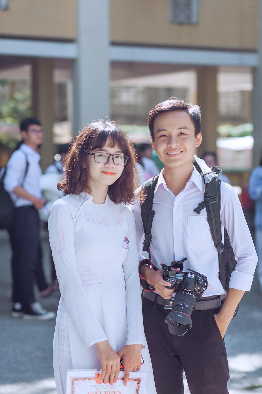 person holding black Canon EOS DSLR camera