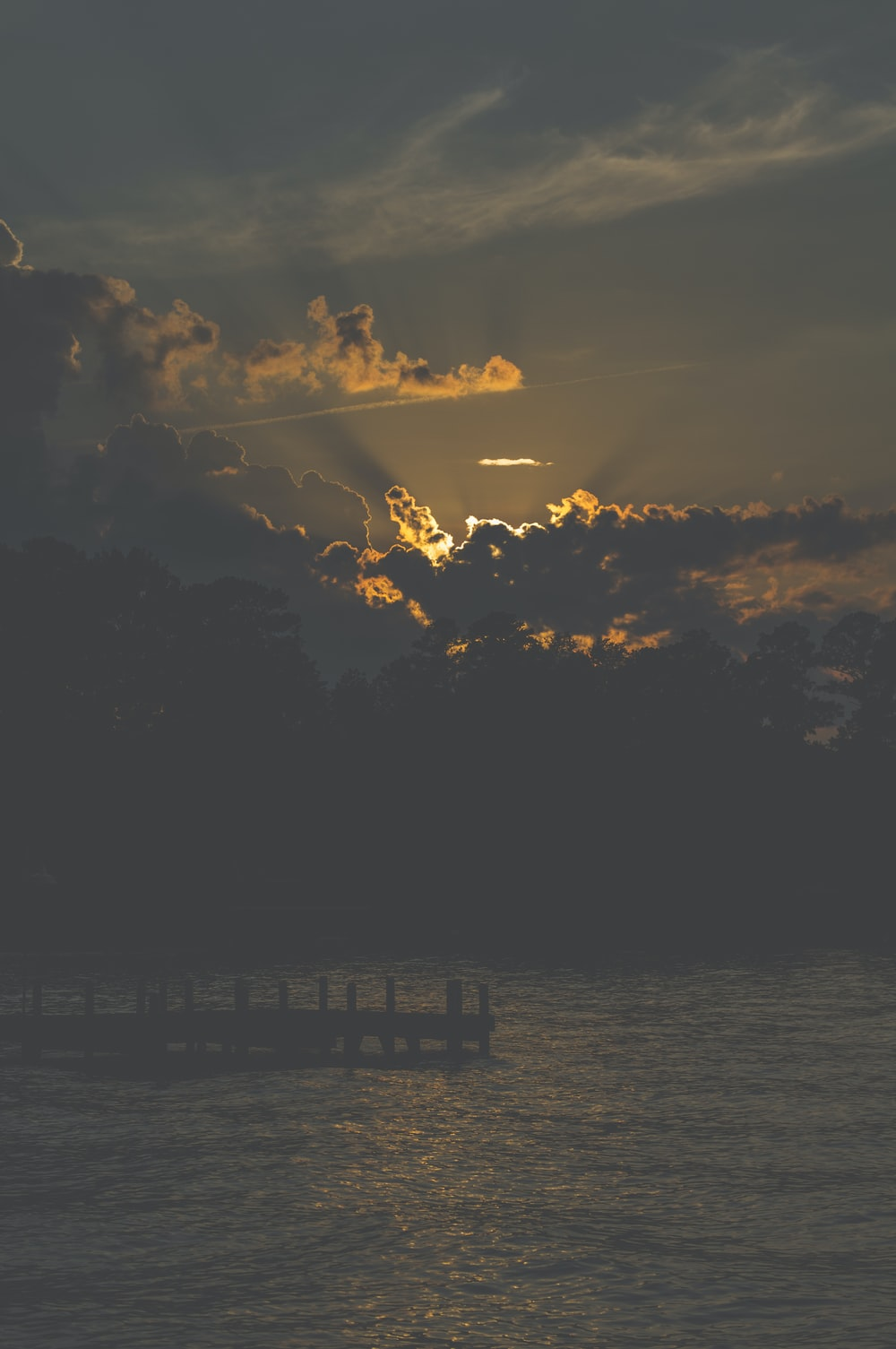 silhouette of dock during sunrise