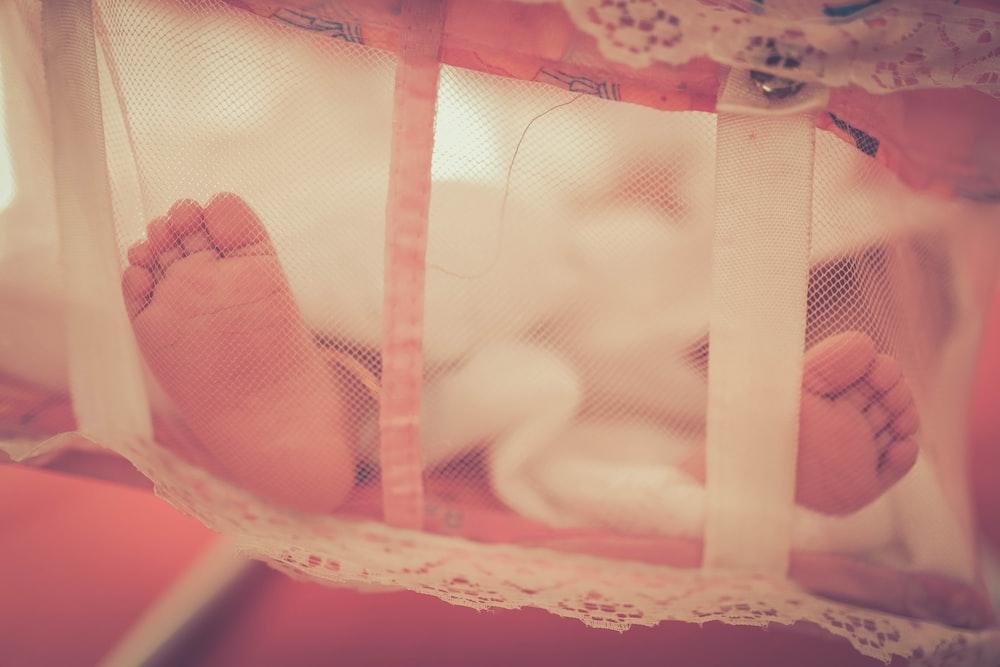 baby laying on crib