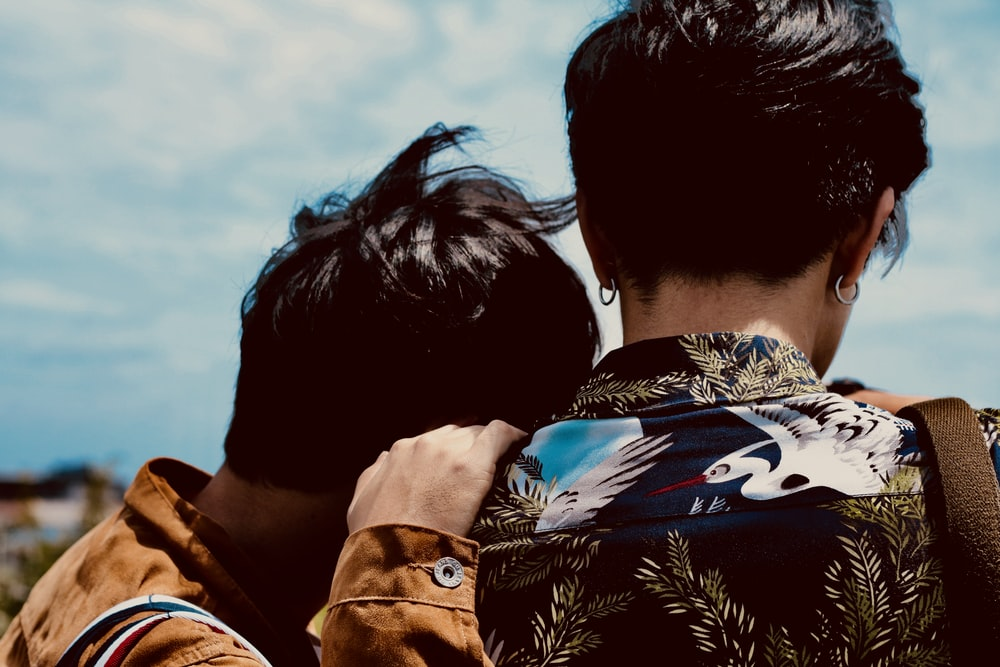 two boy's looking at sky