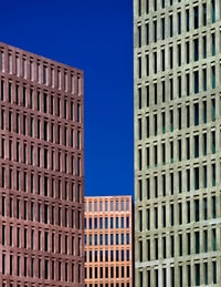 gray high rise building under sunny sky