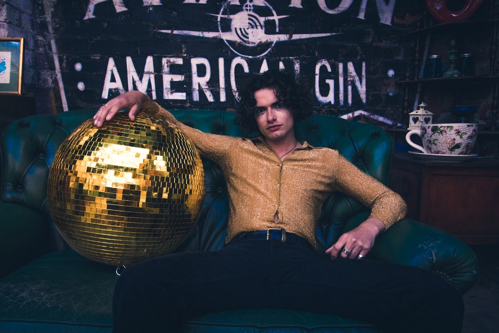 man holding disco ball