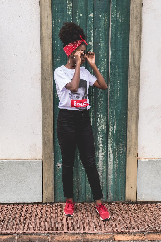 woman standing in front of closed door