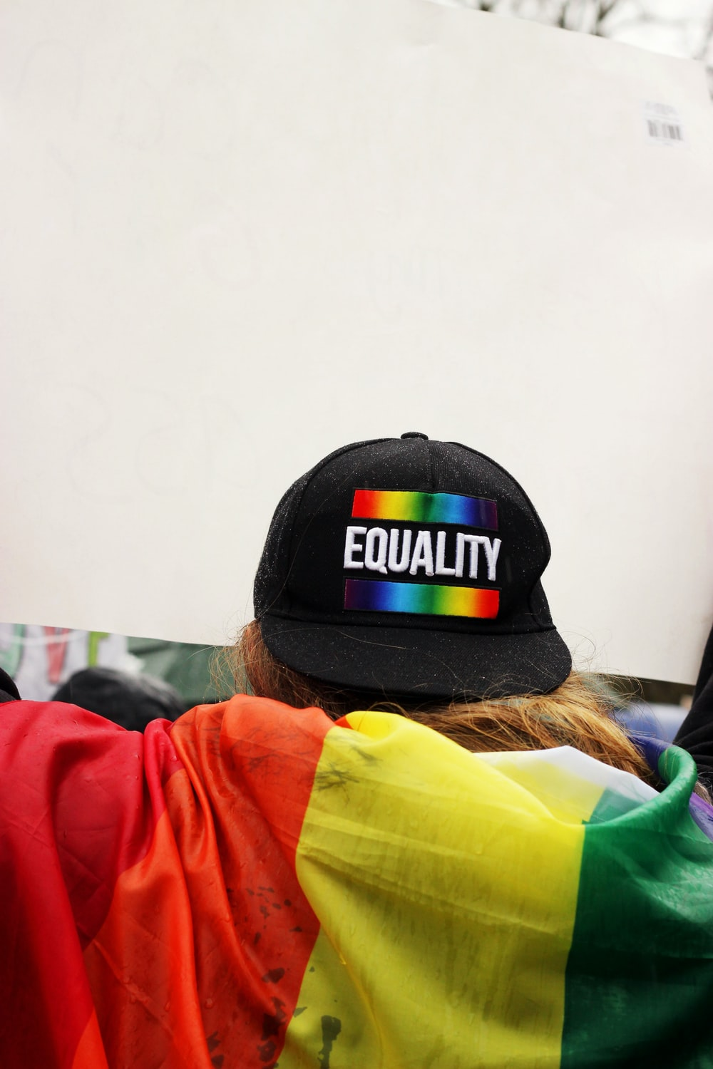 person wearing black Equality printed cap