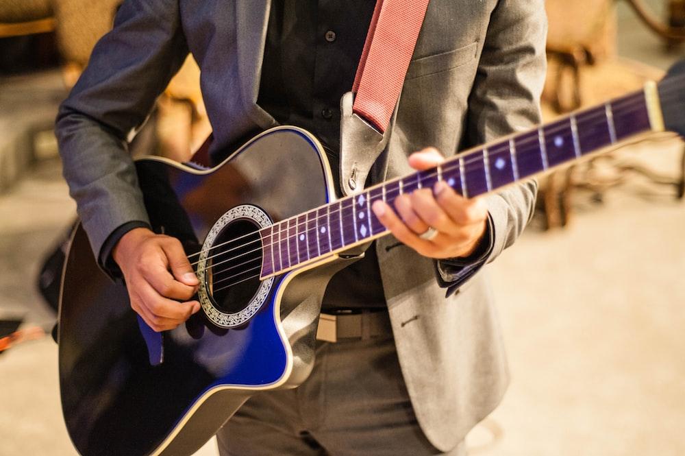 man playing guitar \
