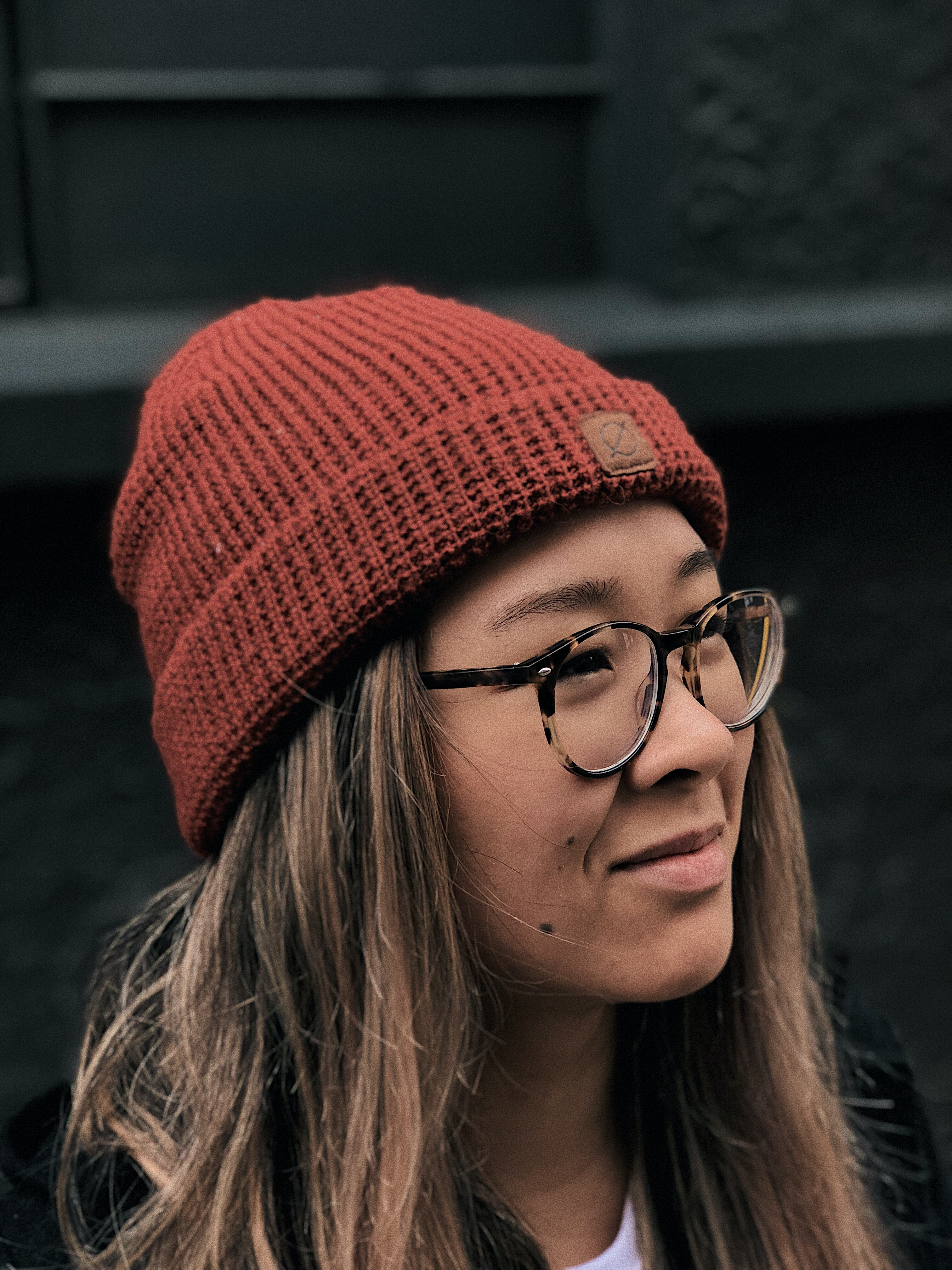 woman wearing knit cap and eyeglasses